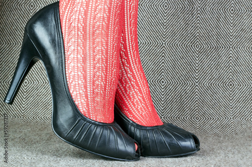 black leather shoes with red tights