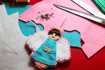 Creating of handicraft felted angel figure