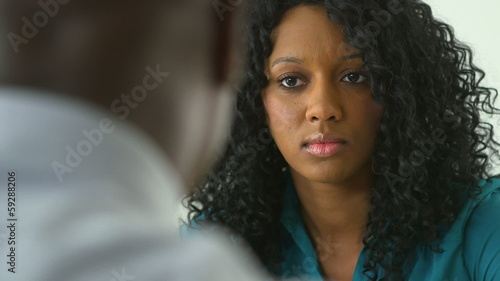 Black business woman talking to co worker in meeting