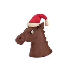 horse's head in a cap of Santa Claus