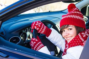Girl in car in winter