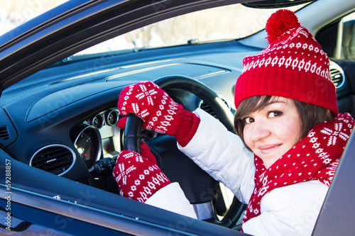 Girl in car in winter