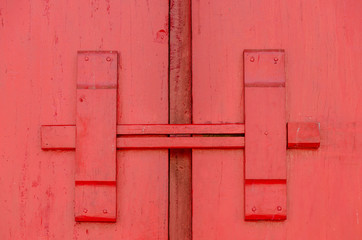 Closeup lock of red wooden door