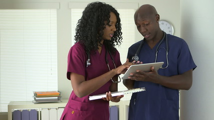 African American medical professionals using tablet pc together