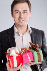 Portrait of a man in a suit with gifts