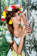 Attractive woman with flower wreath