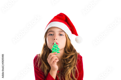Christmas kid girl kissing Xmas tree cookie