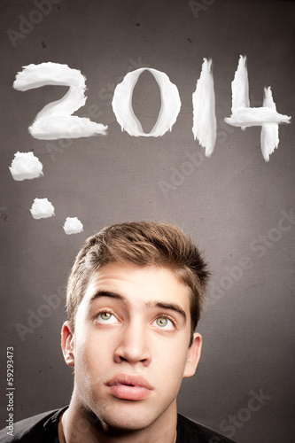 young man with year 2014 over his head