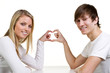 couple showing a heart with their fingers