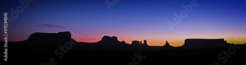 Panoramic photo of Monument Valley at night just before sunrise