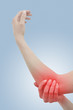 Acute pain in a woman elbow. Female holding hand to spot of elbo