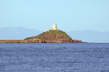Ocean landscape with a old lighthouse on a rock afar off