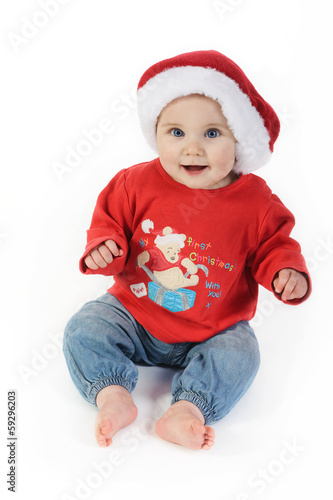 Baby in christmas hat on white background