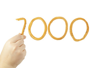 Hand puts the number one thousand of bagels
