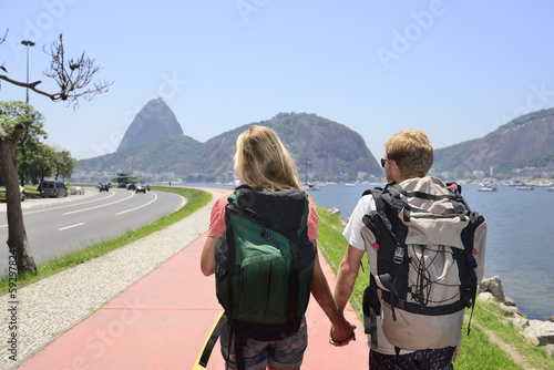 Tourists in Rio de Janeiro with Sugar Loaf on background