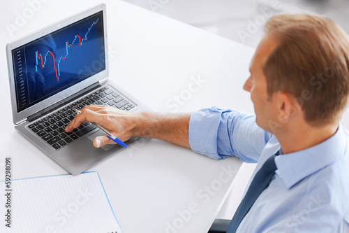 businessman working with forex chart in office
