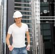 handsome builder in white helmet