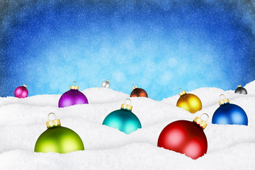 christmas balls and xmas tree in snow