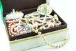jewelry box with jewelry  - Treasure of pearls on white