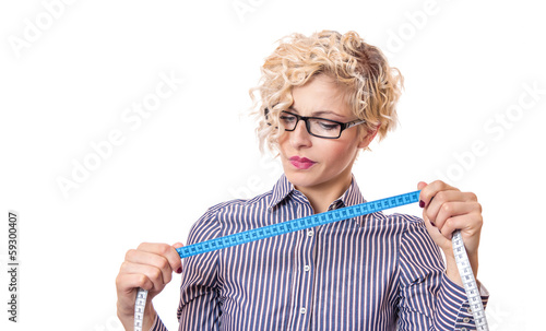 Young businesswoman with measurnig tape, isolated