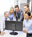 business team with monitor having discussion