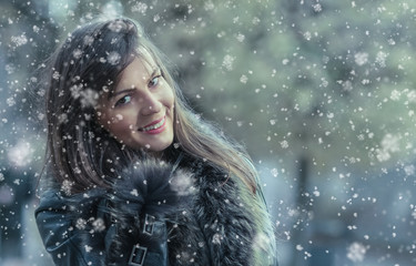 Portrait of a smile young woman in a winter snow