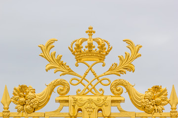 Golden ornate gate of Chateau de Versailles
