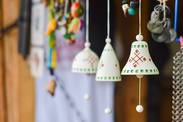 Handmade traditional ceramic jingle bells with ethnic ornament