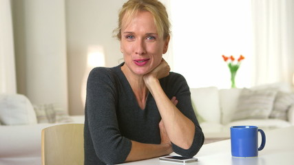 Mature adult woman smiling and talking to camera