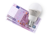 LED bulb over euro bills isolated on white background