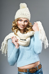 winter picture of beautiful smiling woman wearing woolen sweater