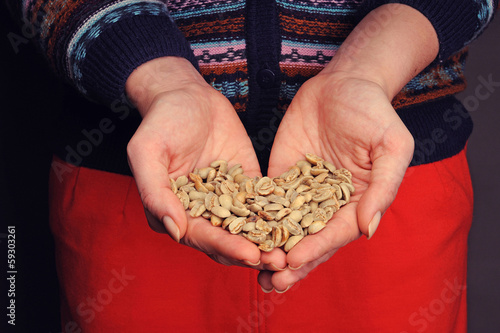 Coffee beans in the hands
