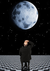 Businessman watching the moon