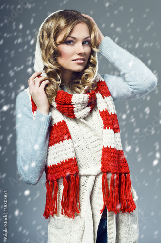 beautiful smiling blonde wearing a woolen sweater and scarf