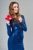 attractive young brunette girl with shining dress and gift box