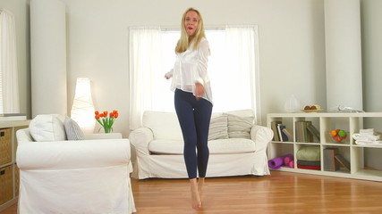 Mature woman dancing in living room
