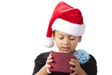 Cute little girl opening a gift
