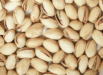 Closeup of pistachios in nut shells as food background