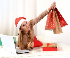 Young beautiful woman online Christmas shopping