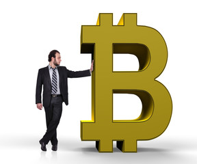 businessman holding bitcoin