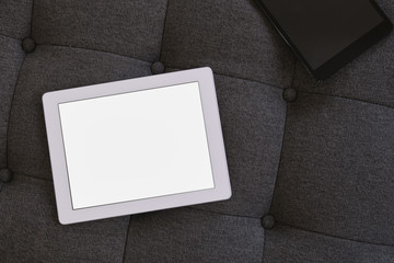 Tablet pc on couch in the office