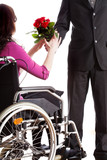 Receiving roses on wheelchair