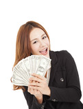 young smiling business woman holding the money