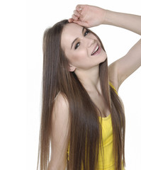 young woman in yellow t-shirt with long straight hair posing