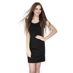 young woman in black sundress with long straight hair posing