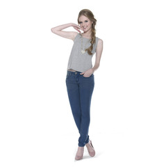 Full body beautiful young woman in jeans a standing