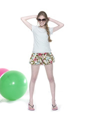 young leisure woman with blue and red ball posing