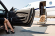 Leinwanddruck Bild - Wealthy Woman Stepping Out Of Car At Terminal