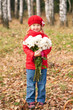 Smiling little kid with bouquet