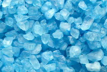 blue crystal bath salt on white background